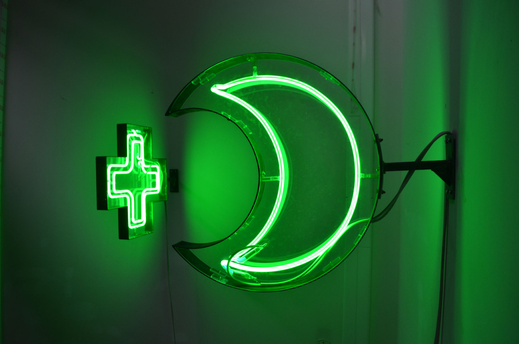 A Green Cross Glows In The Dark Or Is It A Crescent Evi